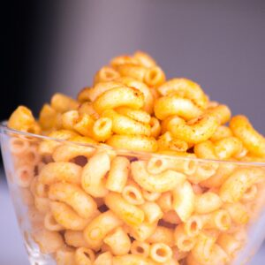 a bowl of orange colored macaroni and cheese made with elbow pasta